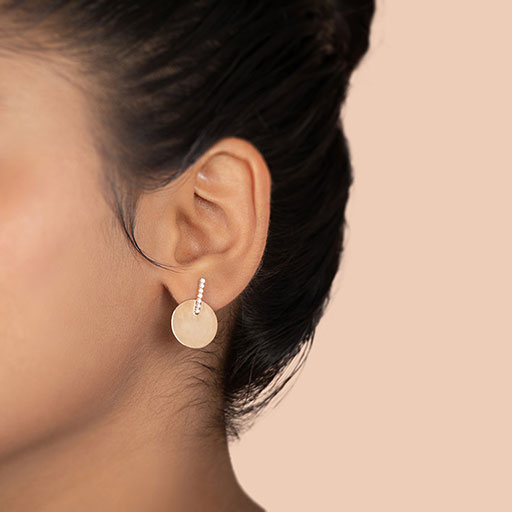clutched-medal-drop-earrings-model